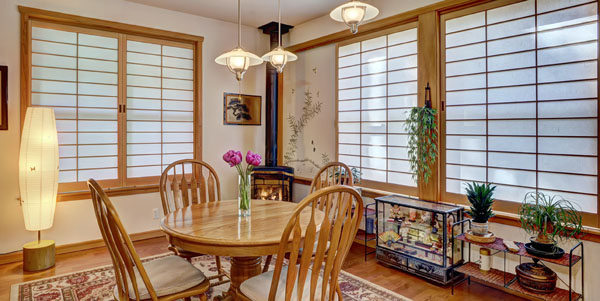 Window shoji screens diffuse light and offer privacy in this dining room