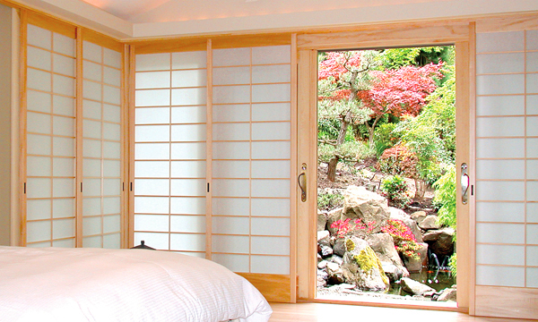 Master bedroom shoji screens slide into a deep pocket on the right side of the window wall