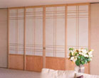 Bipart shoji screen doors between kitchen and living area