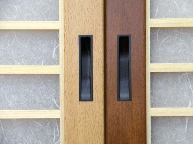 Inlaid Ebony door pulls in natural Beech and stained Beech