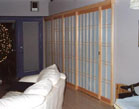 Fixed shoji panels cover wall and create a pocket for the sliding shoji door